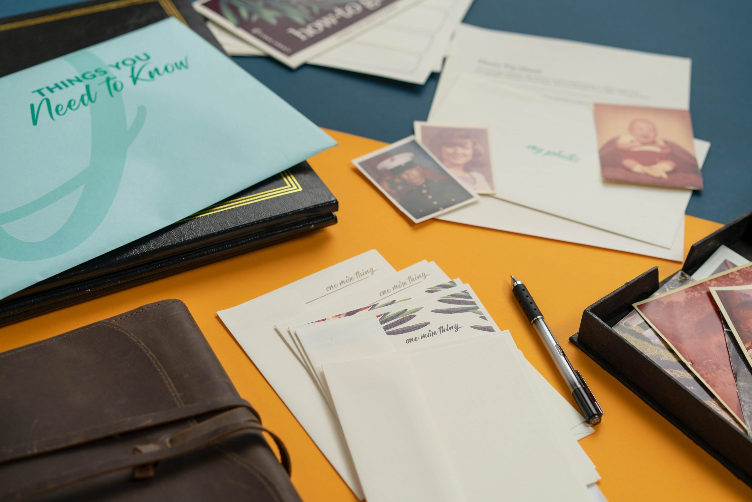 Things You Need to Know Kit by Circa Legacy with photographs, old leather journal, photo album, and pen.