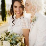 Two beautiful brides prepare for their wedding ceremony.